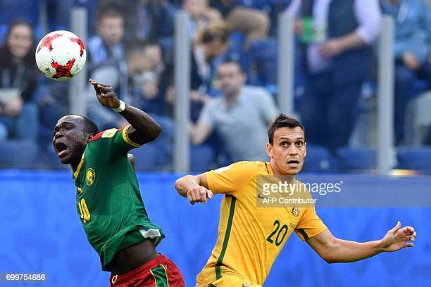 TOPSHOT Cameroon's forward Vincent Aboubakar vies for the ball against Australia's defender Trent Sainsbury during the 2017 Confederations Cup group...