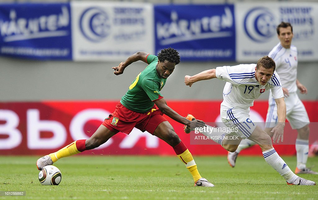 Cameroon's Georges Mandjeck (L) fights for the ball with Slovakian Juraj Kucka (R) during their friendly match in the Hypo Arena Stadium of Klagenfurt on May 29, 2010 prior to the FIFA World Cup 2010 hosted by South Africa between June 11 and July 11.