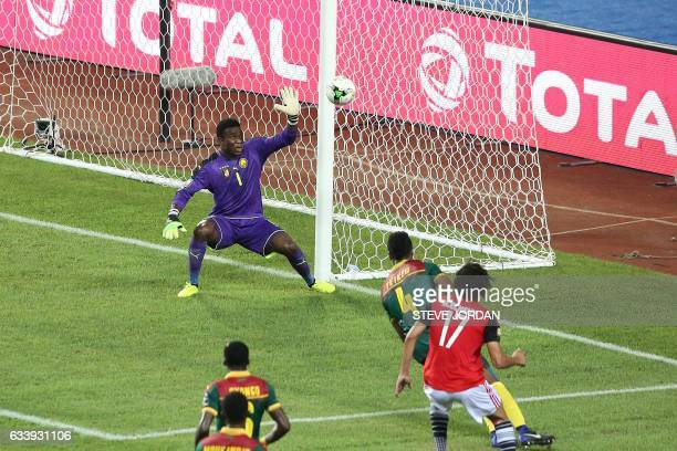 Cameroon's goalkeeper Fabrice Ondoa misses a goal by Egypt's midfielder Mohamed Elneny during the 2017 Africa Cup of Nations final football match...
