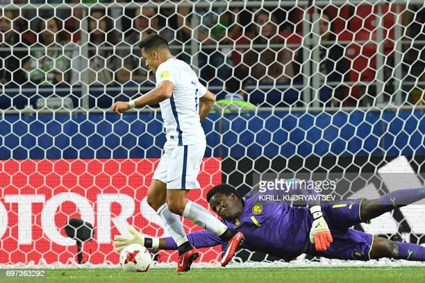 Cameroon's goalkeeper Joseph Ondoa blocks a shot on goal by Chile's forward Alexis Sanchez during the 2017 Confederations Cup group B football match...