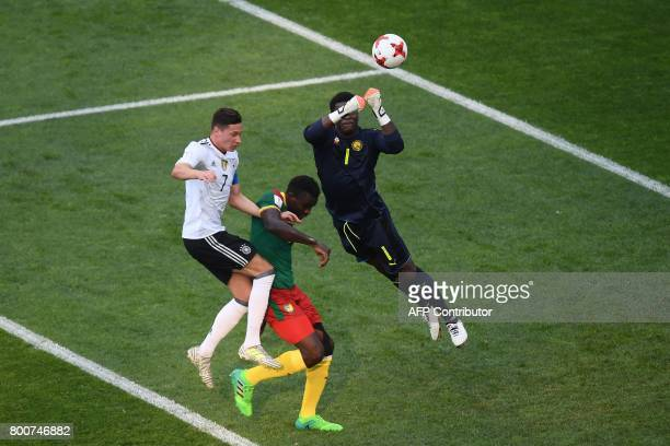 Cameroon's goalkeeper Joseph Ondoa blocks a shot on goal by Germany's midfielder Julian Draxler during the 2017 FIFA Confederations Cup group B...