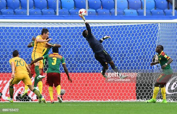 TOPSHOT Cameroon's goalkeeper Joseph Ondoa jumps for the ball during the 2017 Confederations Cup group B football match between Cameroon and...