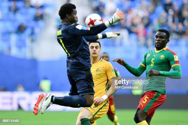TOPSHOT Cameroon's goalkeeper Joseph Ondoa jumps to block the ball during the 2017 Confederations Cup group B football match between Cameroon and...