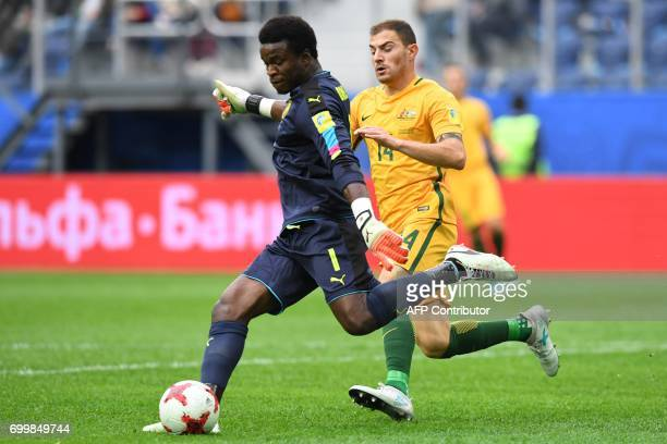 Cameroon's goalkeeper Joseph Ondoa kicks the ball past Australia's forward James Troisi during the 2017 Confederations Cup group B football match...