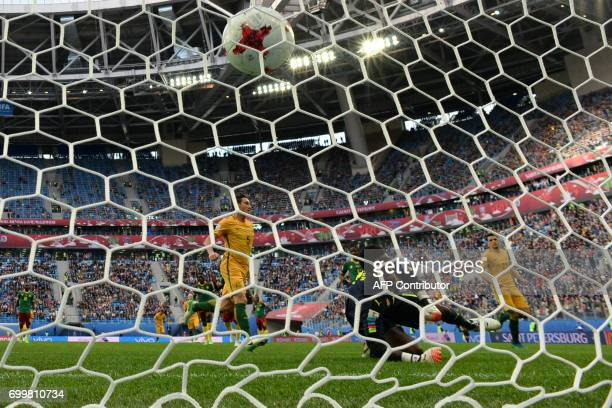 TOPSHOT Cameroon's goalkeeper Joseph Ondoa misses a penalty by Australia's midfielder Mark Milligan during the 2017 Confederations Cup group B...