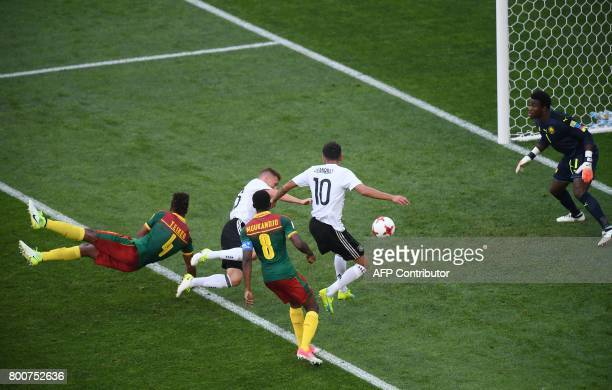Cameroon's goalkeeper Joseph Ondoa prepares to block a shot on goal by Germany's defender Joshua Kimmich and Germany's midfielder Kerem Demirbay...