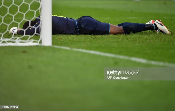 Cameroon's goalkeeper Joseph Ondoa reacts after conceding a goal during the 2017 FIFA Confederations Cup group B football match between Germany and...