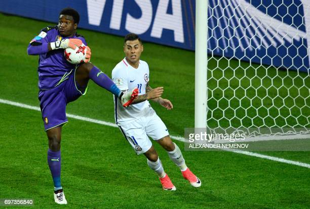 Cameroon's goalkeeper Joseph Ondoa saves a shot on goal by Chile's forward Eduardo Vargas during the 2017 Confederations Cup group B football match...