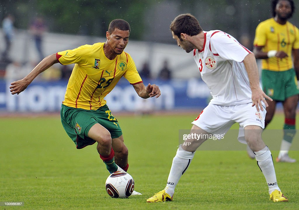Cameroon's Marcel Ndjeng (L) fights for the ball with Georgia's Kia Kandelaki during their international football friendly match in Lienz, on May 25, 2010. AFP PHOTO/Wildbild
