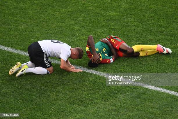 Cameroon's midfielder Andre Zambo and Germany's defender Joshua Kimmich react after a collision during the 2017 FIFA Confederations Cup group B...
