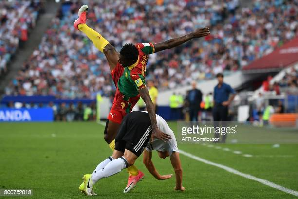 Cameroon's midfielder Andre Zambo falls over Germany's defender Joshua Kimmich during the 2017 FIFA Confederations Cup group B football match between...