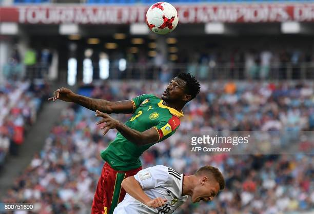 TOPSHOT Cameroon's midfielder Andre Zambo heads the ball over Germany's defender Joshua Kimmich during the 2017 FIFA Confederations Cup group B...