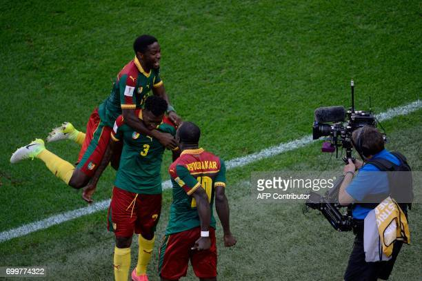 Cameroon's midfielder Andre Zambo is congratulated by Cameroon's defender Collins Fai and Cameroon's forward Vincent Aboubakar after scoring the...