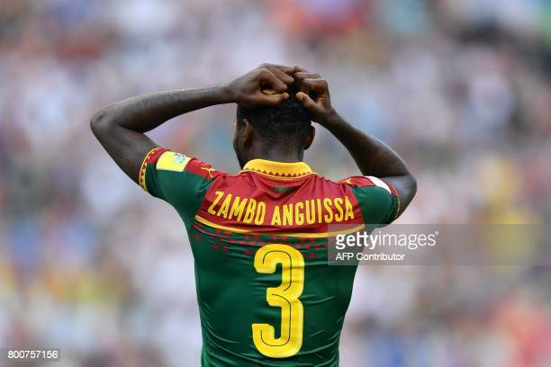 Cameroon's midfielder Andre Zambo reacts after missing a goal opportunity during the 2017 FIFA Confederations Cup group B football match between...