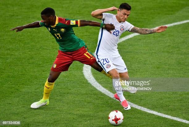 TOPSHOT Cameroon's midfielder Arnaud Djoum challenges Chile's midfielder Charles Aranguiz during the 2017 Confederations Cup group B football match...