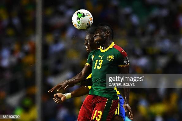 TOPSHOT Cameroon's midfielder Christian Bassogog heads the ball with Gabon's defender Benjamin Ze Ondo during the 2017 Africa Cup of Nations group A...