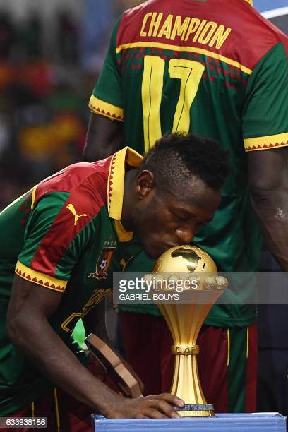 Cameroon's midfielder Christian Bassogog kisses the winner's trophy after Cameroon beat Egypt 21 in the 2017 Africa Cup of Nations final football...