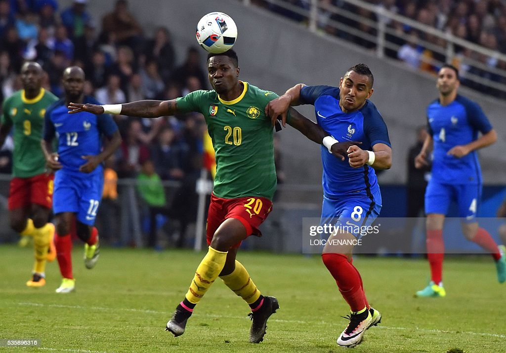 Cameroon's midfielder Georges Mandjeck (L) fights for the ball with France's forward Dimitri Payet (R) during the International friendly football match between France and Cameroon at the Beaujoire stadium, in Nantes, western France, on May 30, 2016 as part of the French team's preparation for the upcoming Euro 2016 European football championships. / AFP / LOIC