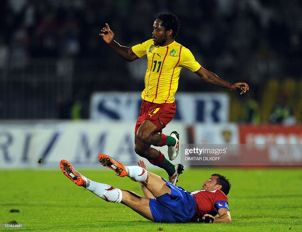 Cameroon's midfielder Jean Makoun (top) jumps over Serbia's midfielder Dejan Stankovic during their friendly in Partizan stadium in Belgrade on June 5, 2010 ahead of the FIFA 2010 World Cup in South Africa.