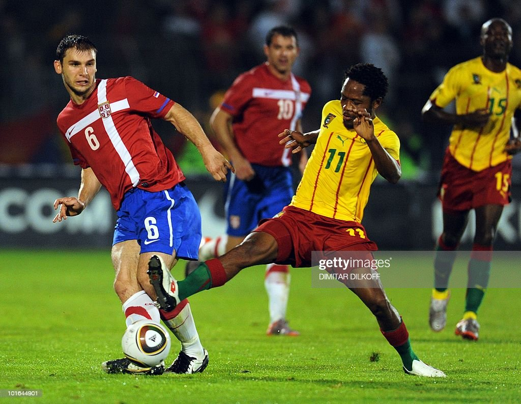 Cameroon's midfielder Jean Makoun (L) vies for the ball with Serbia's midfielder Branislav Ivanovic (R) during their friendly in Partizan stadium in Belgrade on June 5,2010 ahead of the FIFA 2010 World Cup in South Africa.