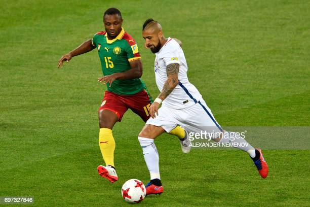Cameroon's midfielder Sebastien Siani challenges Chile's midfielder Arturo Vidal during the 2017 Confederations Cup group B football match between...