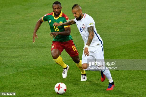 TOPSHOT Cameroon's midfielder Sebastien Siani challenges Chile's midfielder Arturo Vidal during the 2017 Confederations Cup group B football match...