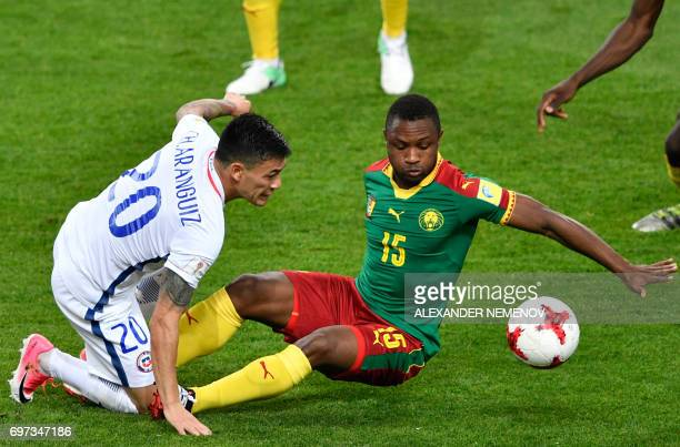 TOPSHOT Cameroon's midfielder Sebastien Siani challenges Chile's midfielder Charles Aranguiz during the 2017 Confederations Cup group B football...