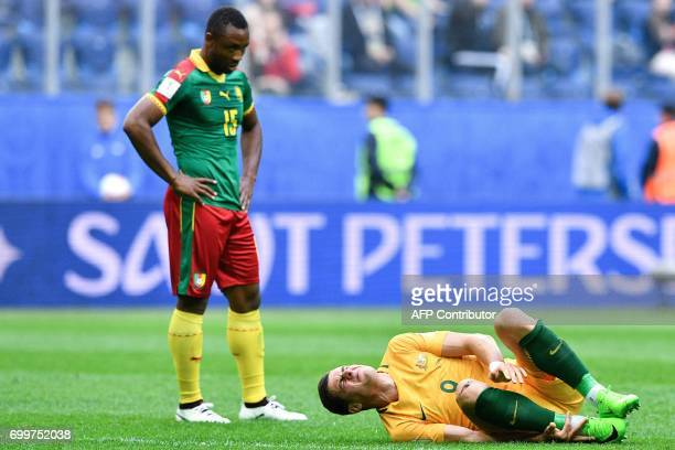 TOPSHOT Cameroon's midfielder Sebastien Siani looks on as Australia's forward Tomi Juric holds his leg grimacing during the 2017 Confederations Cup...