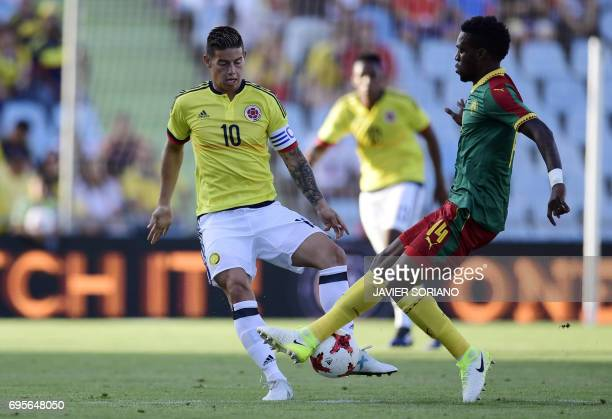 Cameroon's miedfielder Georges Mandjeck vies with Colombia's midfielder James Rodriguez during the friendly football match Cameroon vs Colombia at...