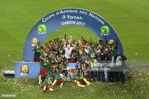 Cameroon's players celebrate with the trophy at the end of the 2017 Africa Cup of Nations final football match between Egypt and Cameroon at the...