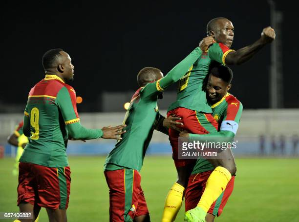 Cameroon's players hug their teammate Vincent Aboubakar after his goal during a friendly football match between Tunisia and Cameroon on March 24 2017...