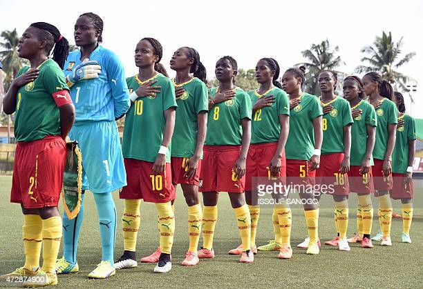 Cameroon's players sing their national anthem before a women friendly football match between Cameroon and Ivory Coast on May 10 2015 at the Robert...