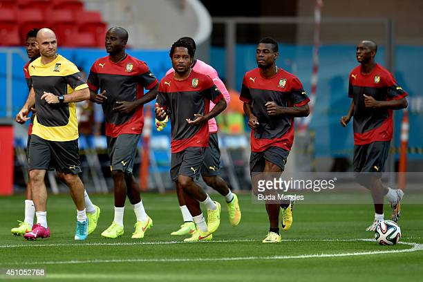 Cameroon's players warm up during a training session at Mane Garrincha Stadium on June 22 2014 in Brasilia Brazil