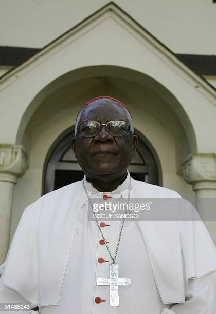 Cameroon's respected opponent archbishop of Douala Christian Tumi poses in front of his diocese in Douala 07 October 2004 before the country...