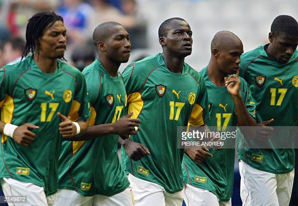 Cameroon's soccer players warm up before the soccer Confederations Cup final match against france 29 June 2003 at the Stade de France in SaintDenis...