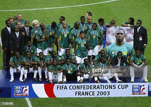 Cameroon's soccer team pose at the end of their soccer Confederations Cup final match against france 29 June 2003 at the Stade de France in...