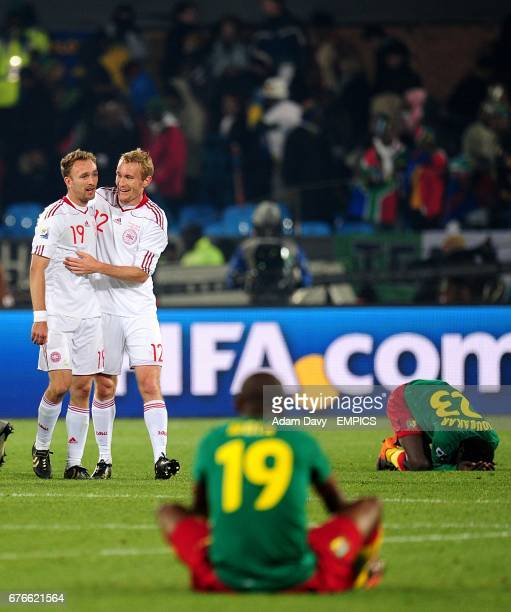 Cameroon's Stephane M'bia Etoundi and Vincent Aboubakar dejected as Denmark's Thomas Kahlenberg and Dennis Rommedahl celebrate victory after the...
