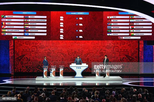 Cameroon's striker Samuel Eto'o FIFA secretary general Jerome Valcke and former Russian goalkeeper Rinat Dasaev hold the preliminary draw for the...