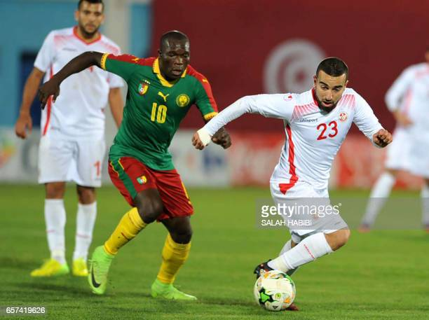 Cameroon's Striker Vincent Aboubakar vies with Tunisian forward Naim Sliti during a friendly football match between Tunisia and Cameroon on March 24...