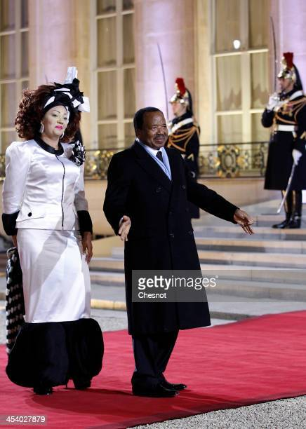 Cameroun's President Paul Biya and his wife Chantal arrive for a diner at the Elysee presidential palace in Paris as part of the Elysee summit for...