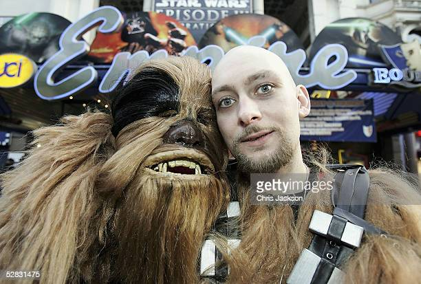 Camerun Wolf Dahl poses with his Chewbacca suit outside the Empire cinema as fans celebrate the London premiere of the final part of the Star Wars...