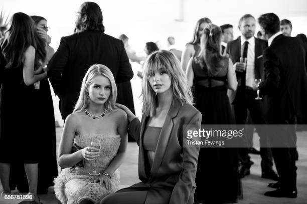 Cami Morrone and Lottie Moss attend the Fashion for Relief event during the 70th annual Cannes Film Festival at Aeroport Cannes Mandelieu on May 21...