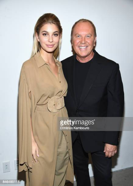 Cami Morrone and Michael Kors pose backstage at Michael Kors Collection Spring 2018 Runway Show at Spring Studios on September 13 2017 in New York...