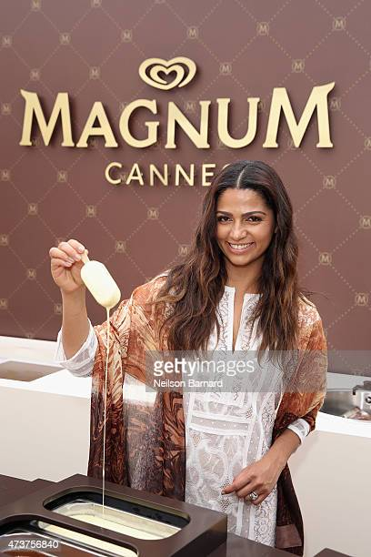 Camila Alves dips a MAGNUM ice cream in white Belgian chocolate while wearing the BCBGMAXAZRIA for MAGNUM Belgian Chocolate Wrap an accessory infused...
