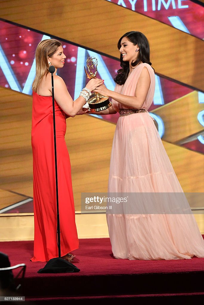 Camila Banus, right, presents the Emmy for Outstanding Entertainment Program in Spanish to Gaby Natale at the 43rd Annual Daytime Emmy Awards at the Westin Bonaventure Hotel on May 1, 2016 in Los Angeles, California.