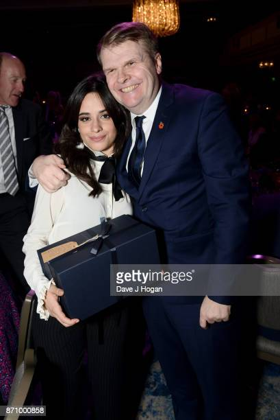 Camila Cabello and Rob Stringer attend the 26th annual Music Industry Trust Awards held at The Grosvenor House Hotel on November 6 2017 in London...