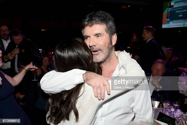 Camila Cabello and Simon Cowell attend the 26th annual Music Industry Trust Awards held at The Grosvenor House Hotel on November 6 2017 in London...