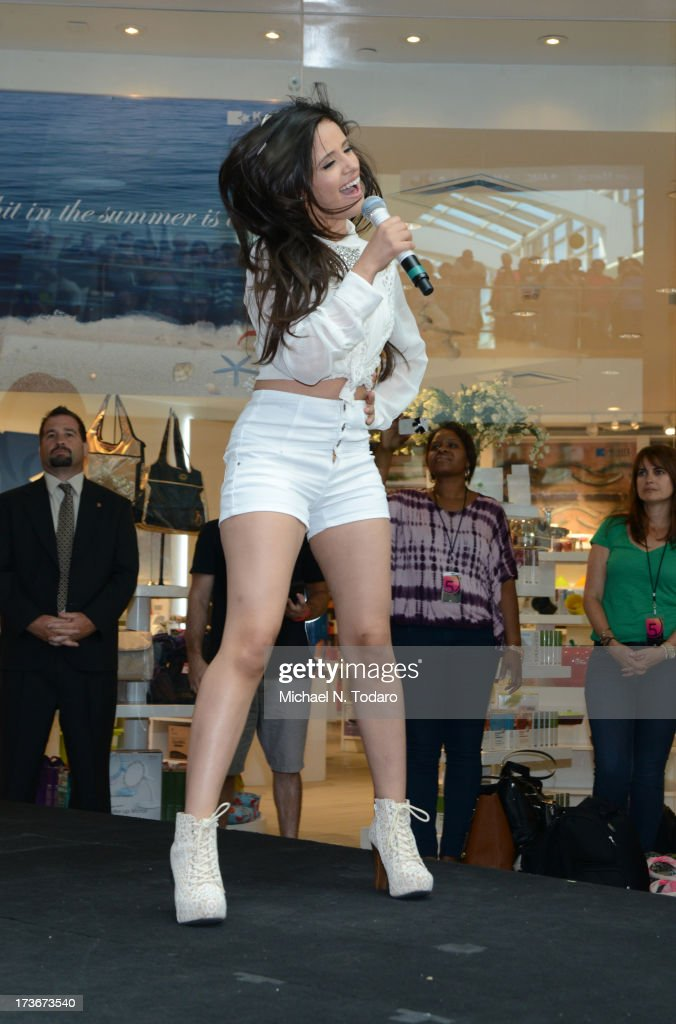 Camila Cabello of Fifth Harmony peforms at Garden State Plaza on July 16, 2013 in Paramus, New Jersey.