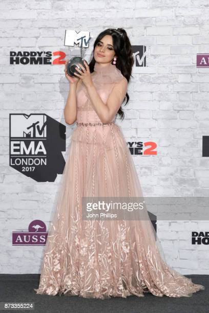 Camilla Cabello poses with the award for Best Pop in the winner's room during the MTV EMAs 2017 held at The SSE Arena Wembley on November 12 2017 in...