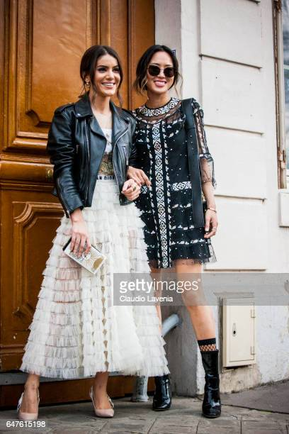 Camila Coelho and Aimee Song are seen in the streets of Paris after the Christian Dior show during Paris Fashion Week Womenswear Fall/Winter...